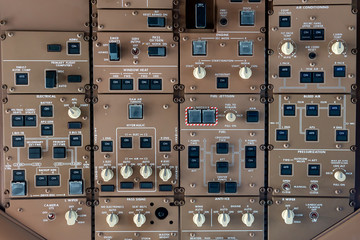 control panel knobs and buttons in a big jet plane cockpit