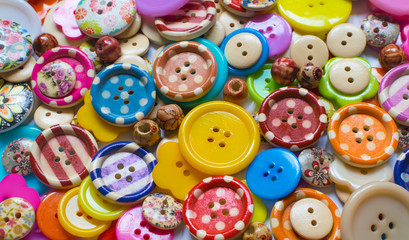 Full frame and selective focus photo of various and colorful sewing buttons