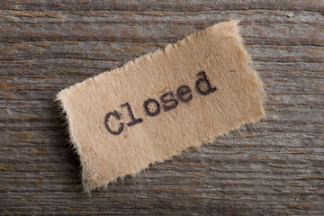 Closed - word on a piece of paper close up Wall mural