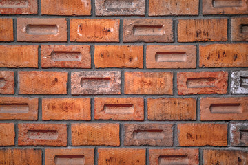 Red brown brick wall close up background