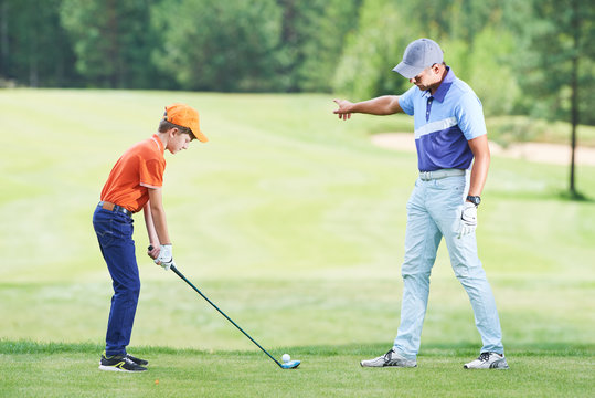 Boy playing golf in summer