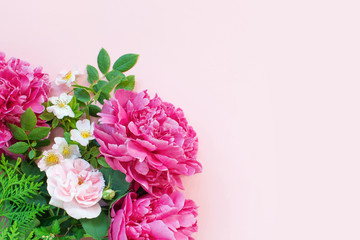 Wall Mural - Pink floral background, blooming peonies and roses with green leaves