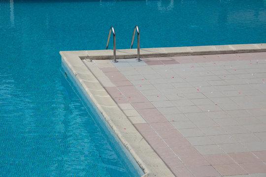 Metal swimming pool ladder in detail corner
