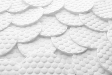 Many cotton pads as background, closeup view