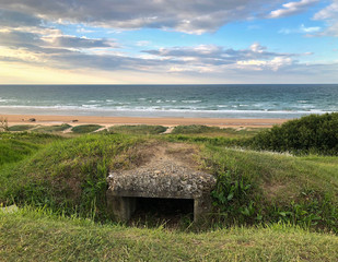 Nazi German pillbox fortification built during WWII above Normandy beach in France.