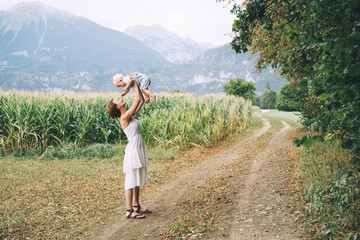 Mother and baby outdoors. Family on nature.