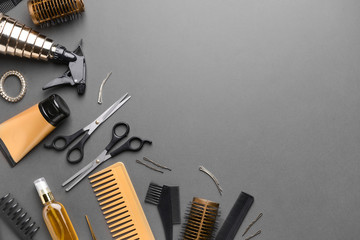 Set of hairdresser tools and accessories on dark background