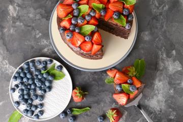 Tasty chocolate cake on grunge background
