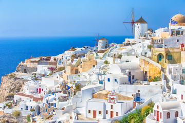 Poster de jardin Santorini Travel Destinations. Picturesque Cityscape of Oia Village in Santorini Island Located on Volcanic Calderra at Daytime. Traditional Windmills on Background.