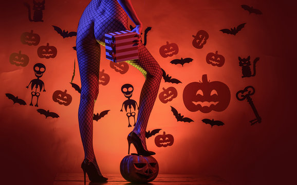 Erotic ladies Halloween concept. Sexy buttocks. Lingerie for Halloween. Sexy Model Posing In Lingerie on halloween background. Female with sexy ass posing.