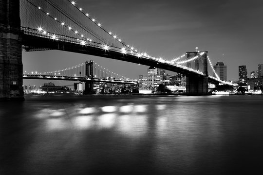 Black and White  Picture of the Brooklyn Bridge Lighted Up At Night
