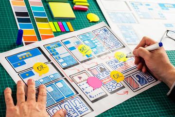 Designer of digital web products. Detailed web prototyping process. Web designer creates a landing...