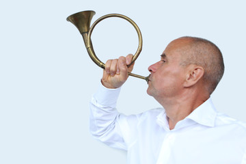 man in a white shirt, a businessman blowing a pipe, a postal horn on a white background