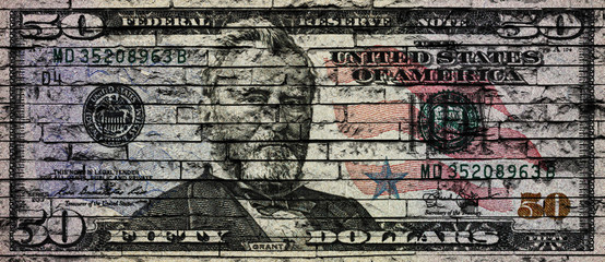 US Dollar banknote on a brick wall