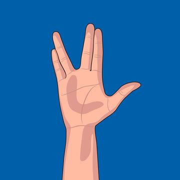 Hand gesture on blue background. Raised hand with the palm forward and the thumb extended, while the fingers are parted between the middle and ring finger.