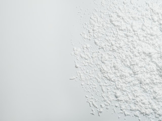White foam stained abstract art background. Closeup of solid color surface splashed with mousse. Copy space.