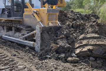 the process of operating a modern bulldozer in the preparation of a new construction site
