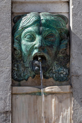 drinking water fountain in the shape of a human head in the Portuguese capital of Lisbon