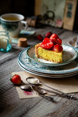 Slice of homemade delicious strawberry tart or pie with sweet glazed berries on top