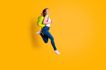 Full length body size view photo of lovely funny funky she her lady youth speed run runner high-school have bag feel excited content isolated dressed fashionable sneakers singlet colorful background Fototapete
