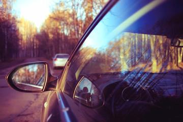 car autumn road, sun, concept autotravel