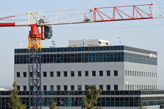 Construction crane and new office building in Yehud city in central Israel.