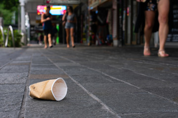 Disposable cup littered on sidewalk Wall mural
