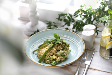 Risotto with spinach and green asparagus. Appetizing dish
