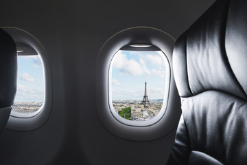 Wall Mural - Traveling Paris, France famous landmark and travel destination in Europe. Aerial view Eiffel Tower through airplane window