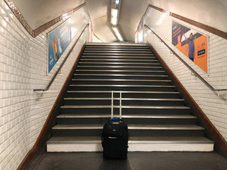 A camera case is seen at the bottom of a flight of metro stairs during the Women's World Cup soccer tournament in Paris