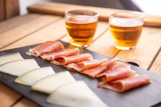 beer and cheese and serrano ham board from spain