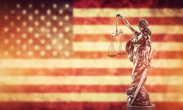 Themis statue against USA flag.