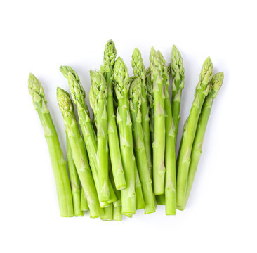 fresh asparagus isolated on white background. top view