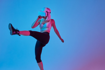 Woman doing fitness in VR headset