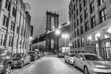 Wall Mural - Night view of the Empire State Building through the pylons of Manhattan Bridge. View from Washington Street in Dumbo