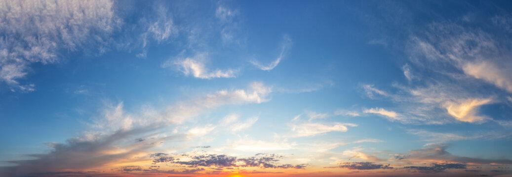 Sunset cloudy sky with orange sun