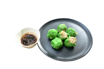 steamed Chinese jade dumpling filling minced shrimp or dim sum dipping soy sauce on plate
