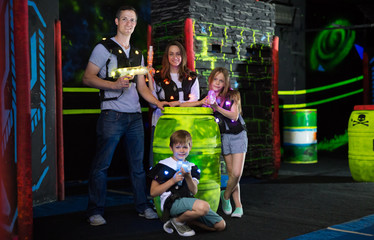Family posing with laser pistols