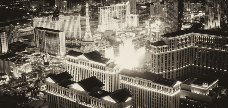 LAS VEGAS, NV - JUNE 30, 2018: Night lights of the Strip from helicopter, black and white view. Las Vegas is a famous gambling destination