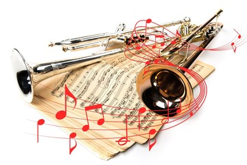 Trumpets and vintage notes on white background