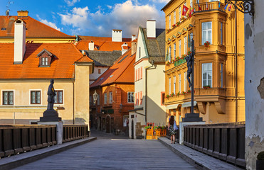 Fototapete - Czech Krumlov Czech Republic view with old wooden bridge at antique town with red tegular roof. Scenic landscape landmark and travel.