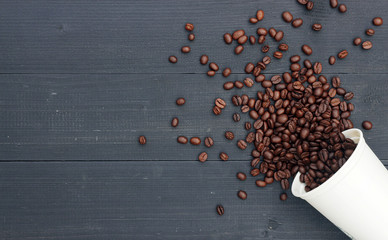coffee bean in white hot cup on black wood background