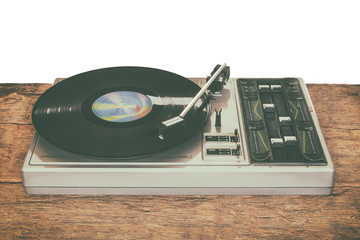 Old record player on a wooden table