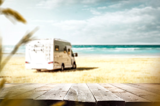 desk of free space and summer background of camping