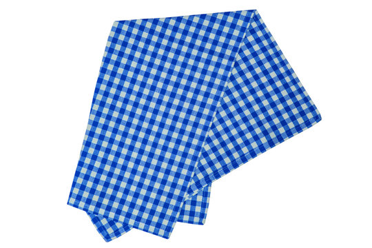 Closeup of a blue and white checkered napkin or tablecloth isolated on white background. Kitchen accessories.