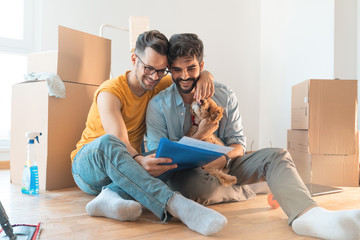 Gay couple just moved in - Stock Image