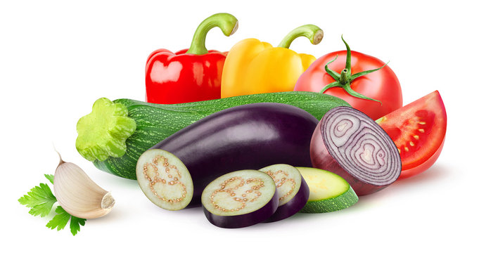 Isolated ratatouille ingredients. Raw cut vegetables (zucchini, eggplant, tomato, onion, pepper, garlic) isolated on white background with clipping path