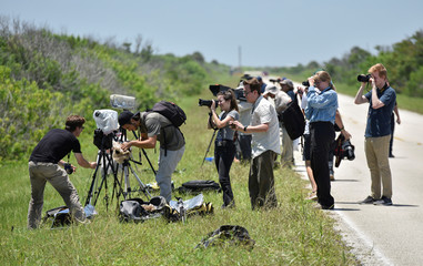 Photographers set up remote cameras for the launch of a SpaceX Falcon Heavy rocket, carrying the U.S. Air Force's Space Test Program-2 mission, at the Kennedy Space Center in Cape Canaveral