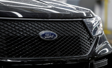 The logo of Ford is seen on a 2020 Ford Explorer car at Ford's Chicago Assembly Plant in Chicago