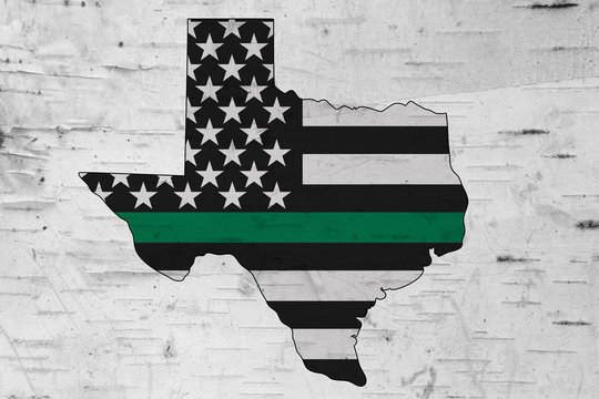 American thin green line flag on map of Texas